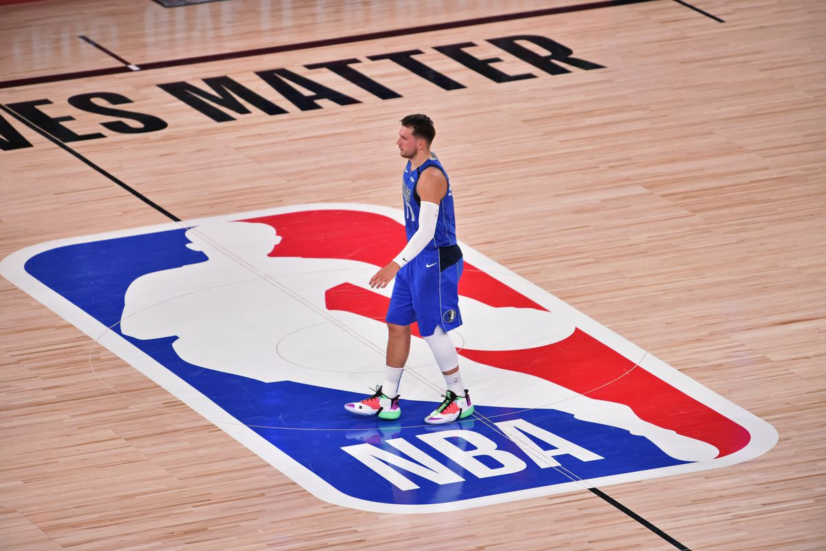 Luka Doncic of the Dallas Mavericks stands at center court against the LA Clippers during Round One, Game Five of the NBA Playoffs on August 25, 2020 in Orlando, Florida at AdventHealth Arena.