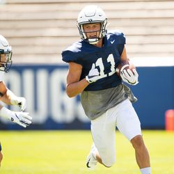 BYU wide receiver Dax Milne, right, runs with the ball during the Cougars' practice Wednesday, Aug. 21, 2019 at LaVell Edwards Stadium in Provo.