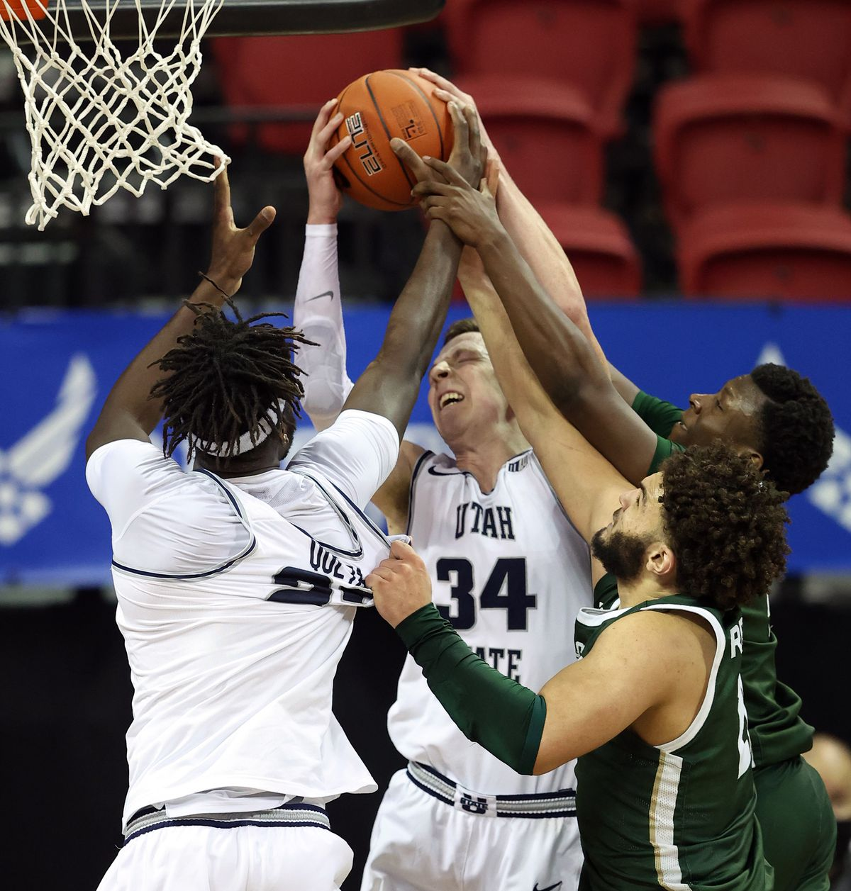 Utah State Aggies center Neemias Queta (23) has his jersey pulled by Colorado State Rams guard David Roddy (21) as he and teammate Utah State Aggies forward Justin Bean (34) go after a rebound as Utah State and Colorado State play in the Mountain West Tournament at the Thomas & Mack Center in Las Vegas on Friday, March 12, 2021. Utah State won 62-50.