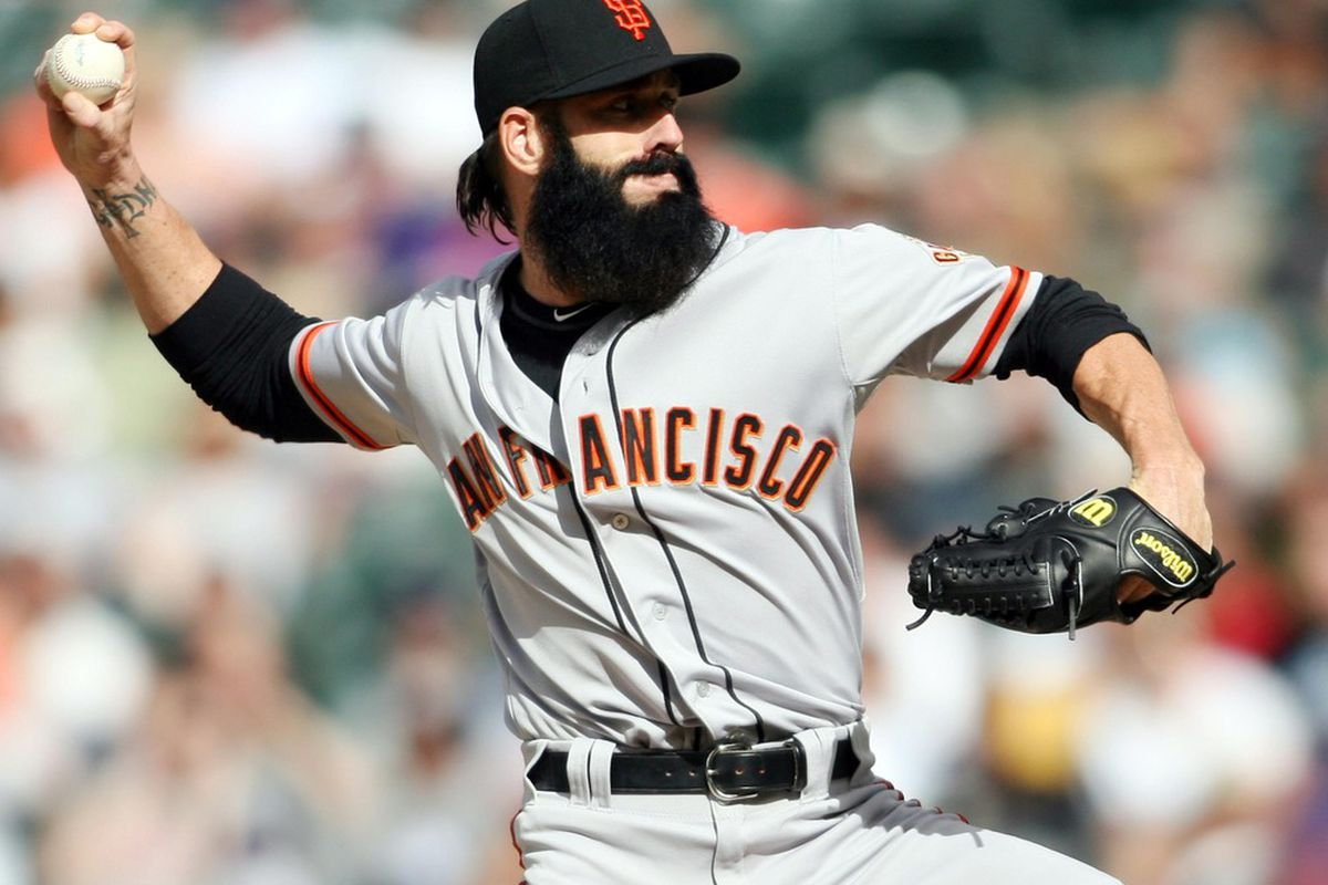 April 12, 2012; Denver, CO, USA; San Francisco Giants pitcher Brian Wilson delivers a pitch during the ninth inning against the Colorado Rockies at Coors Field.  The Giants won 4-2.  Mandatory Credit: Chris Humphreys-US PRESSWIRE
