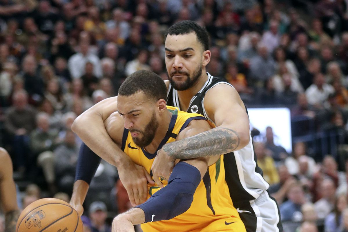 Utah Jazz center Rudy Gobert (27) loses the ball as San Antonio Spurs center Trey Lyles (41) grabs him during an NBA game at Vivint Arena in Salt Lake City on Friday, Feb. 21, 2020.The Jazz lost 104-113.