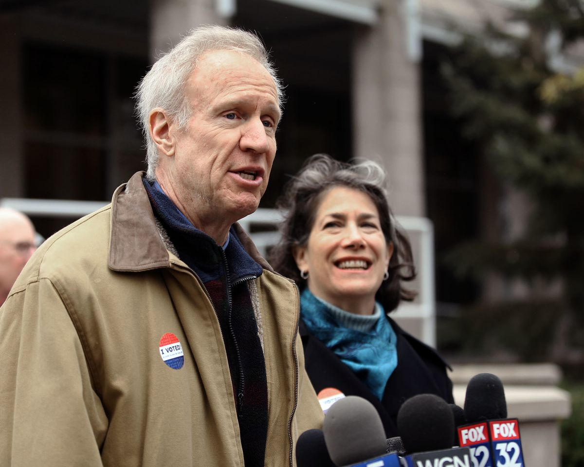 Gov. Bruce Rauner talks to reporters after voting at the Divine Mercy Parish Center in Winnetka in 2018 as his wife, Diana looks on.