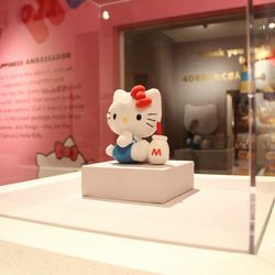 """Sitting atop a pyramid is this tiny Hello Kitty doll posed just like the one on the original coin purse. It's meant to remind guests that she's not just a pop culture icon. """"Hello Kitty was created to bring happiness to the world,"""" says Janet Hsu, preside"""