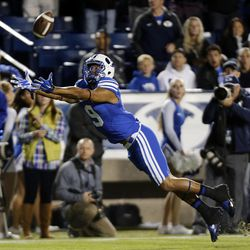 Jordan Leslie (9) of the Brigham Young University Cougars reaches but can't catch this pass against USU during NCAA football in Provo, Friday, Oct. 3, 2014.