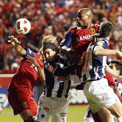 Jamison Olave (top) of Real Salt Lake heads the ball toward the goal over Duilio Davino from the Rayados of Monterrey during the final game of the CONCACAF championship at Rio Tinto Stadium in Sandy Wednesday, April 27, 2011.