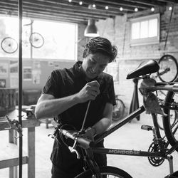 Austin Taylor works on a bicycle at the Provo Bicycle Collective.