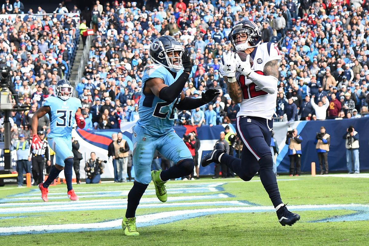 Houston Texans wide receiver Kenny Stills catches a touchdown pass in front of coverage from Tennessee Titans cornerback Logan Ryan during the first half at Nissan Stadium.