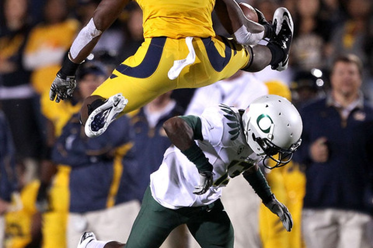 BERKELEY CA - NOVEMBER 13:  Jeremy Ross #3 of the California Golden Bears jumps over Cliff Harris #13 of the Oregon Ducks at California Memorial Stadium on November 13 2010 in Berkeley California. (Photo by Ezra Shaw/Getty Images)
