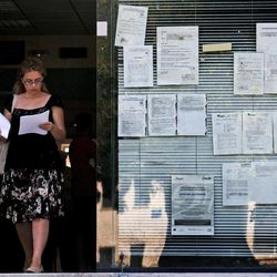 A woman leaves an unemployment bureau in Athens on Thursday, Sept. 6, 2012. Greece's unemployment rate surged to 24.4 percent in June as the number of people out of work in June rose by 34,000 to more than 1.2 million.