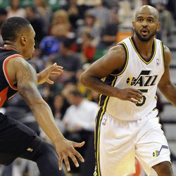 Utah Jazz point guard John Lucas III (5) brings the ball up court as Portland Trail Blazers point guard Damian Lillard (0) defends in the second half of a game at the Energy Solutions Arena on Wednesday, October 16, 2013.