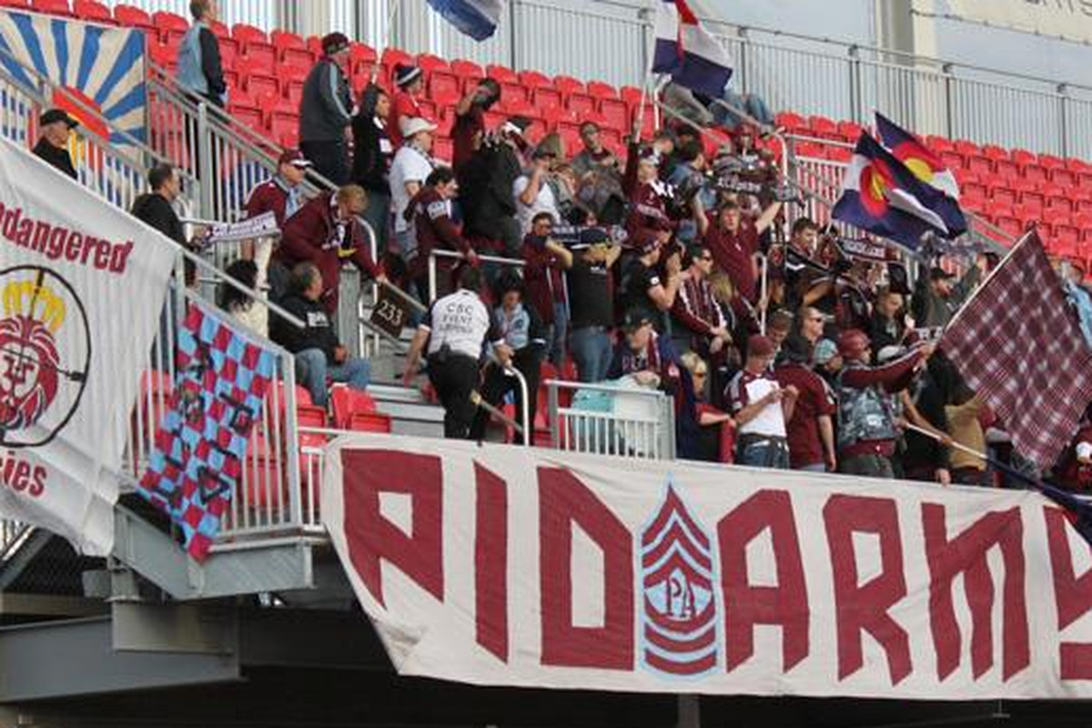 I was among a gang of Rapids fans that traveled to Rio Tinto Stadium last Saturday. (If you're morbidly curious, I'm the guy in the burgundy shirt holding up the black scarf.)
