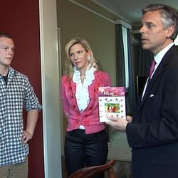 Will Huntsman, left, listens to his dad, former U.S. Ambassador Jon Huntsman Jr., with his mom, former Utah first lady Mary Kay Huntsman, middle, inside their Beijing residence in March of 2011.