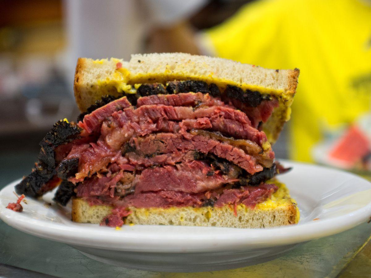 Half of a pastrami sandwich on a plate at Katz's Delicatessen