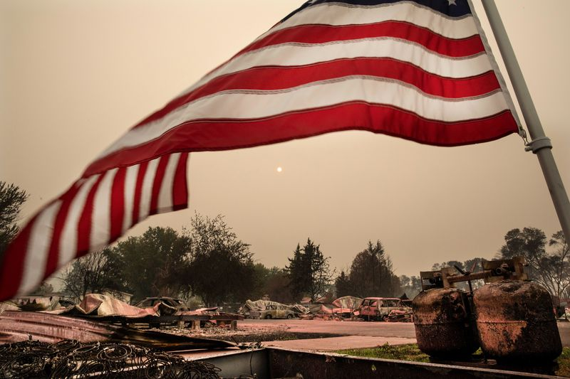 Charred cars and structures seen destroyed in the Almeda Fire in Talent, Oregon