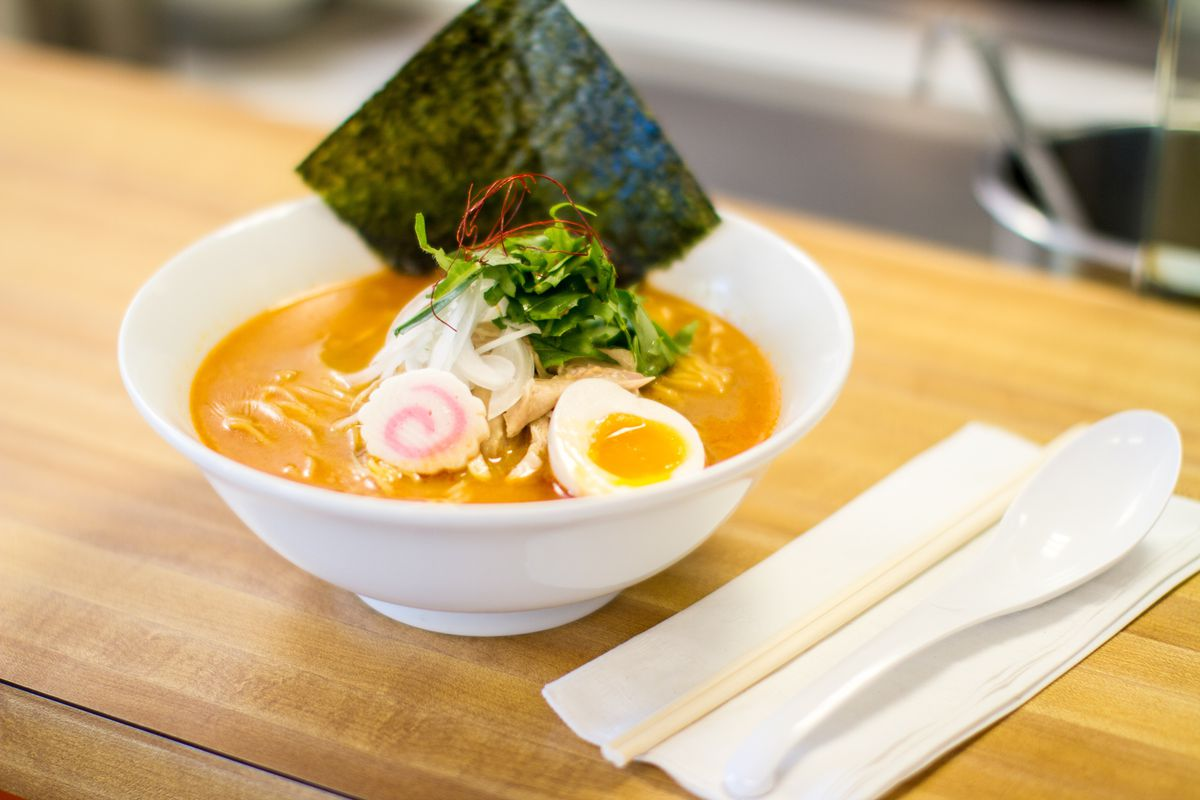 Ramen from Bantam King on a wood counter with silverware