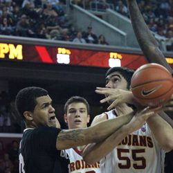 Omar Oraby is fouled by Dustin Thomas.