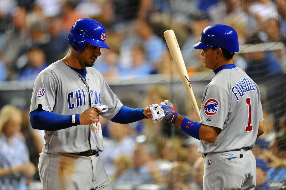 Carlos Pena of the Chicago Cubs is congratulated by Kosuke Fukudome after scoring a run against the Kansas City Royals at Kauffman Stadium on June 24, 2011 in Kansas City, Missouri. (Photo by G. Newman Lowrance/Getty Images)