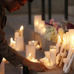 Candles are left on the steps of the Park Building during a candlelight vigil for ChenWei Guo at the University of Utah in Salt Lake City on Wednesday, Nov. 1, 2017. Guo who was shot and killed during a car jacking.