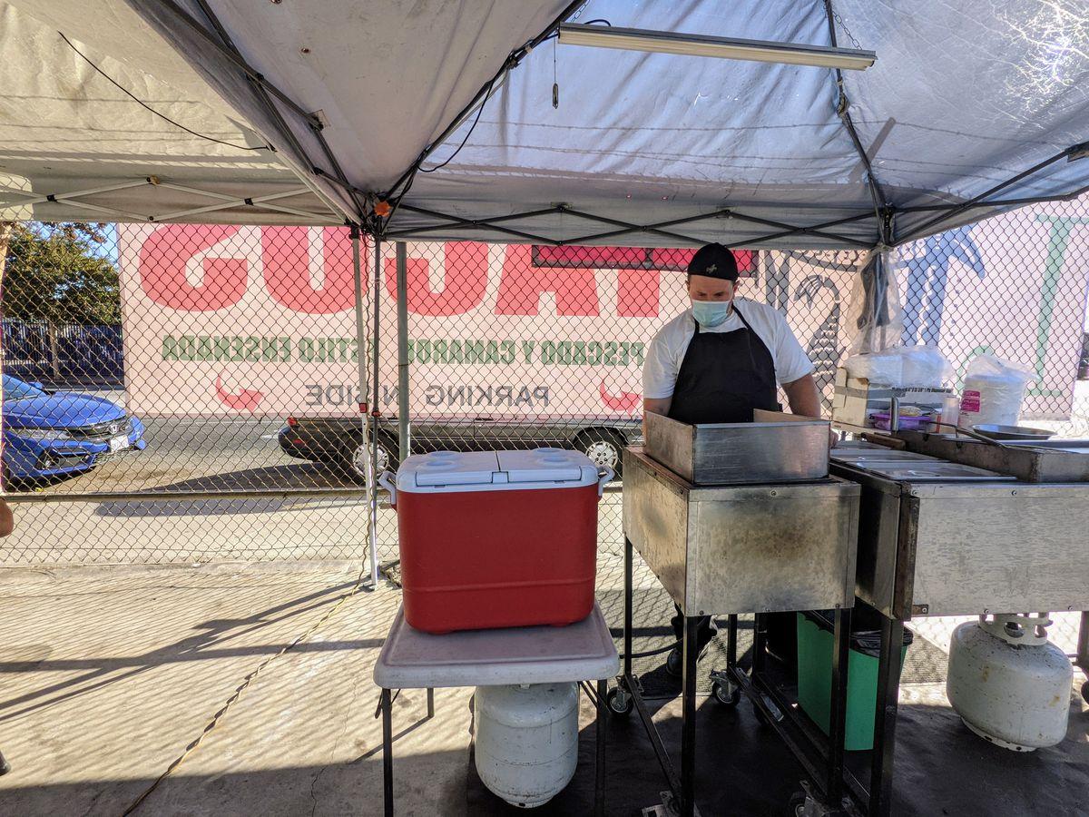 Ulysses Sanchez fries up fish tacos in his East LA stand L Fish.