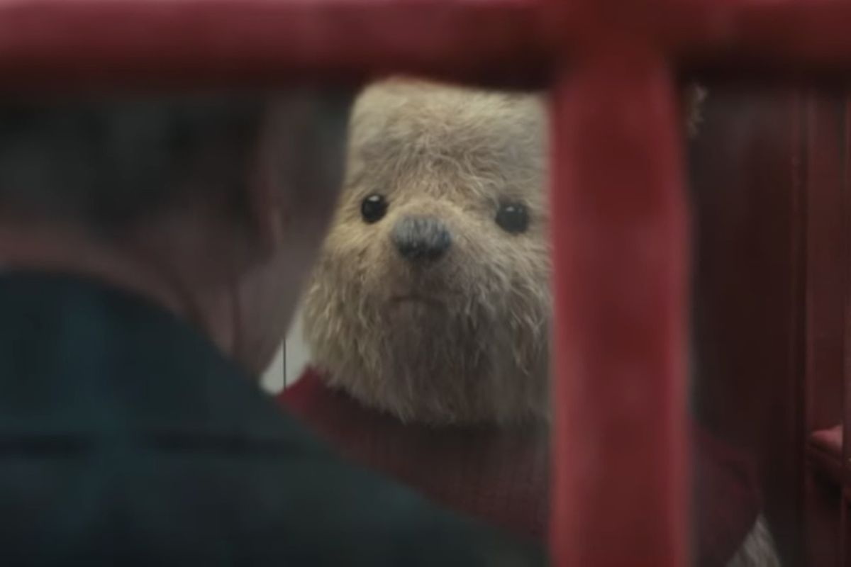 """Christopher Robin talks with Winnie the Pooh in a telephone booth in a new trailer for the film """"Christopher Robin."""""""