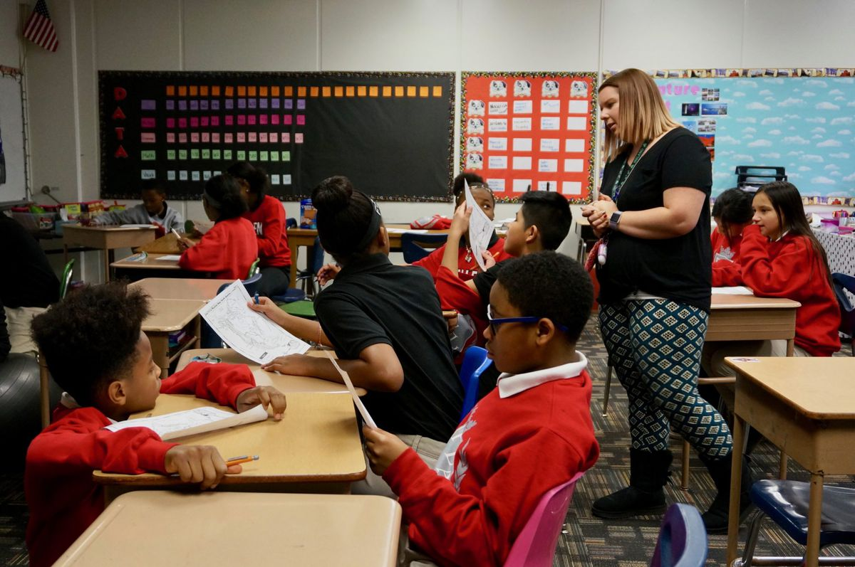 Students in Caroline Brooks' class fill out geography worksheets, closely reading the map for information. Brooks hopes the students will learn skills that help them on the state test. January 9, 2019.