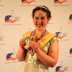 Utah Valley University culinary student Madeline Black grins with her gold medal at the American Culinary Federation Cook. Craft. Create. national convention on July 8-13 in Orlando, Florida. Black was named the National Student Chef of the Year after making truffle-scented duck roulade finished in duck fat, with Utah honey lacquered duck thigh-riblet.