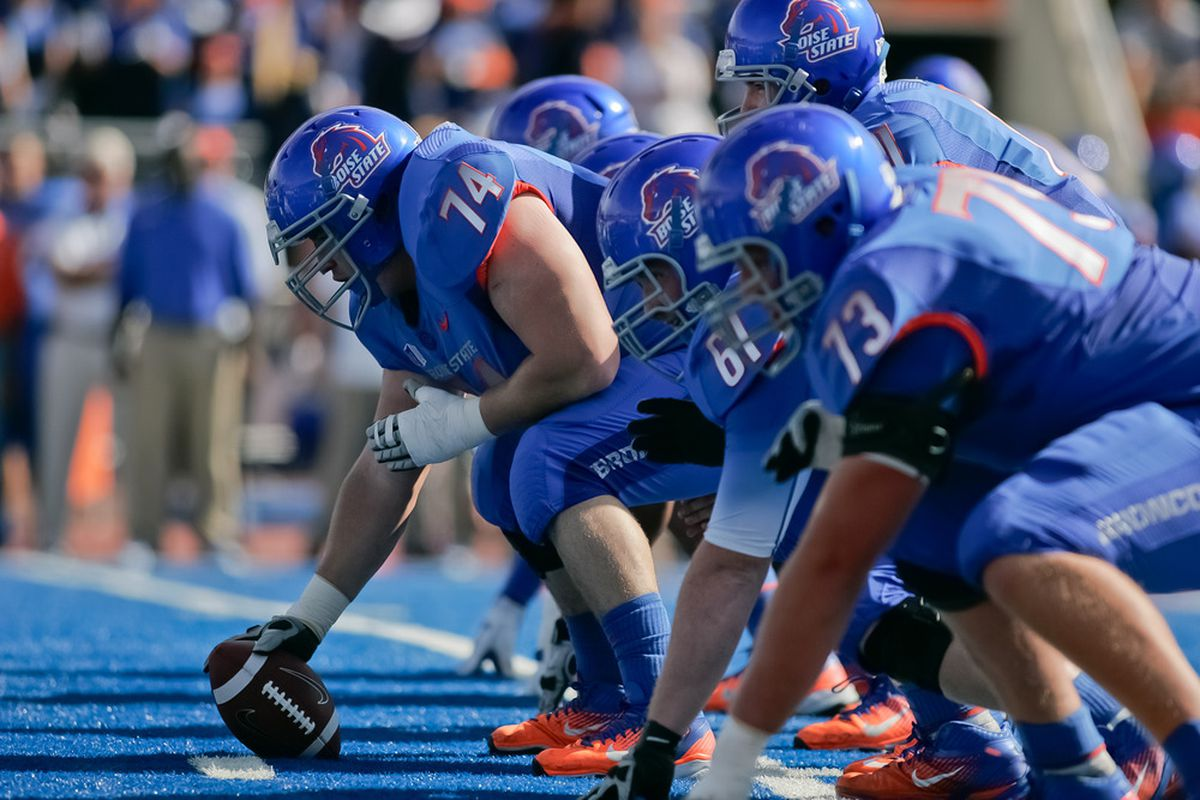 BOISE, ID - OCTOBER 01:  Cory Yriarte #74 of the Boise State Broncos prepares to snap the ball against the Nevada Wolf Pack at Bronco Stadium on October 1, 2011 in Boise, Idaho.  (Photo by Otto Kitsinger III/Getty Images)