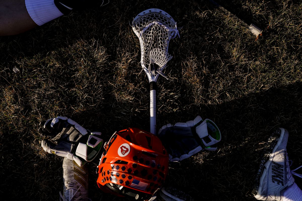 Brighton players rest and talk during time out in a lacrosse game against Bingham in South Jordan on Tuesday, March 10, 2020.