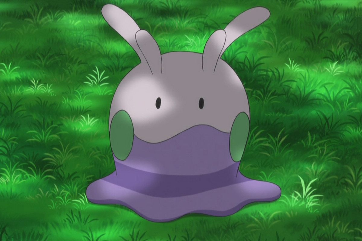 Goomy stands under some shade on grass