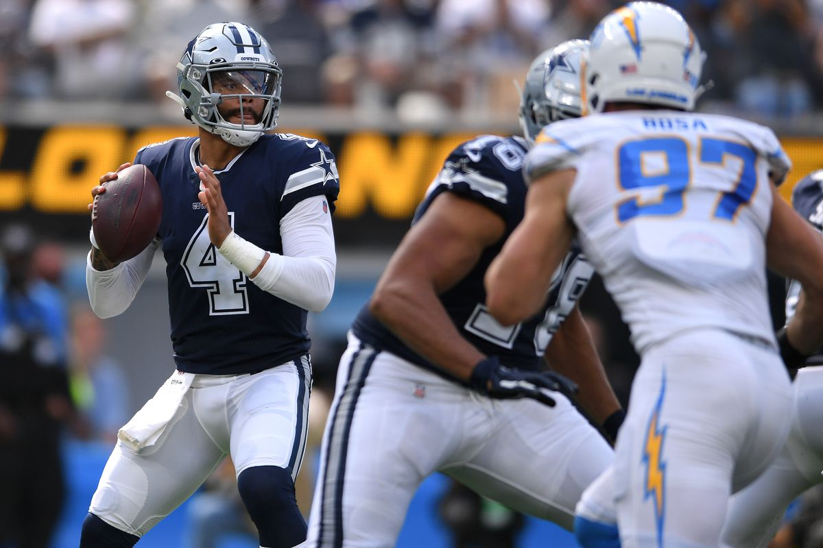 Dallas Cowboys quarterback Dak Prescott (4) looks to pass against the Los Angeles Chargers during the first half at SoFi Stadium.