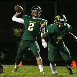 Waubonsie Valley's Ethan Nelson (2) throws a pass.