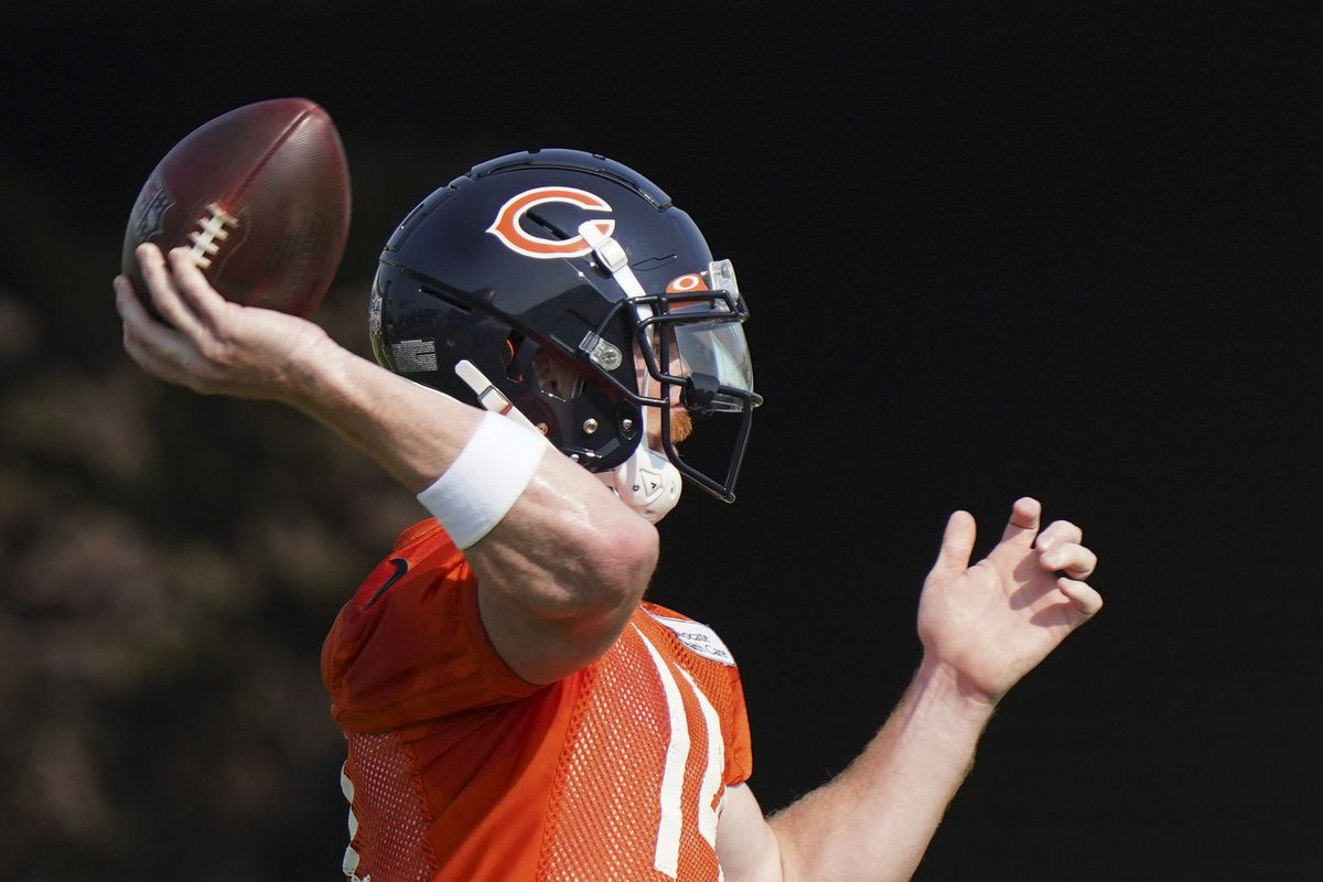 Bears quarterback Andy Dalton throws a pass in training camp.