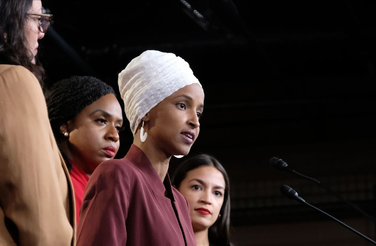 """Rep. Ilhan Omar with the rest of """"The Squad"""" — Rep. Rashida Tlaib, Rep. Ayanna Pressley, and Rep. Alexandria Ocasio-Cortez."""