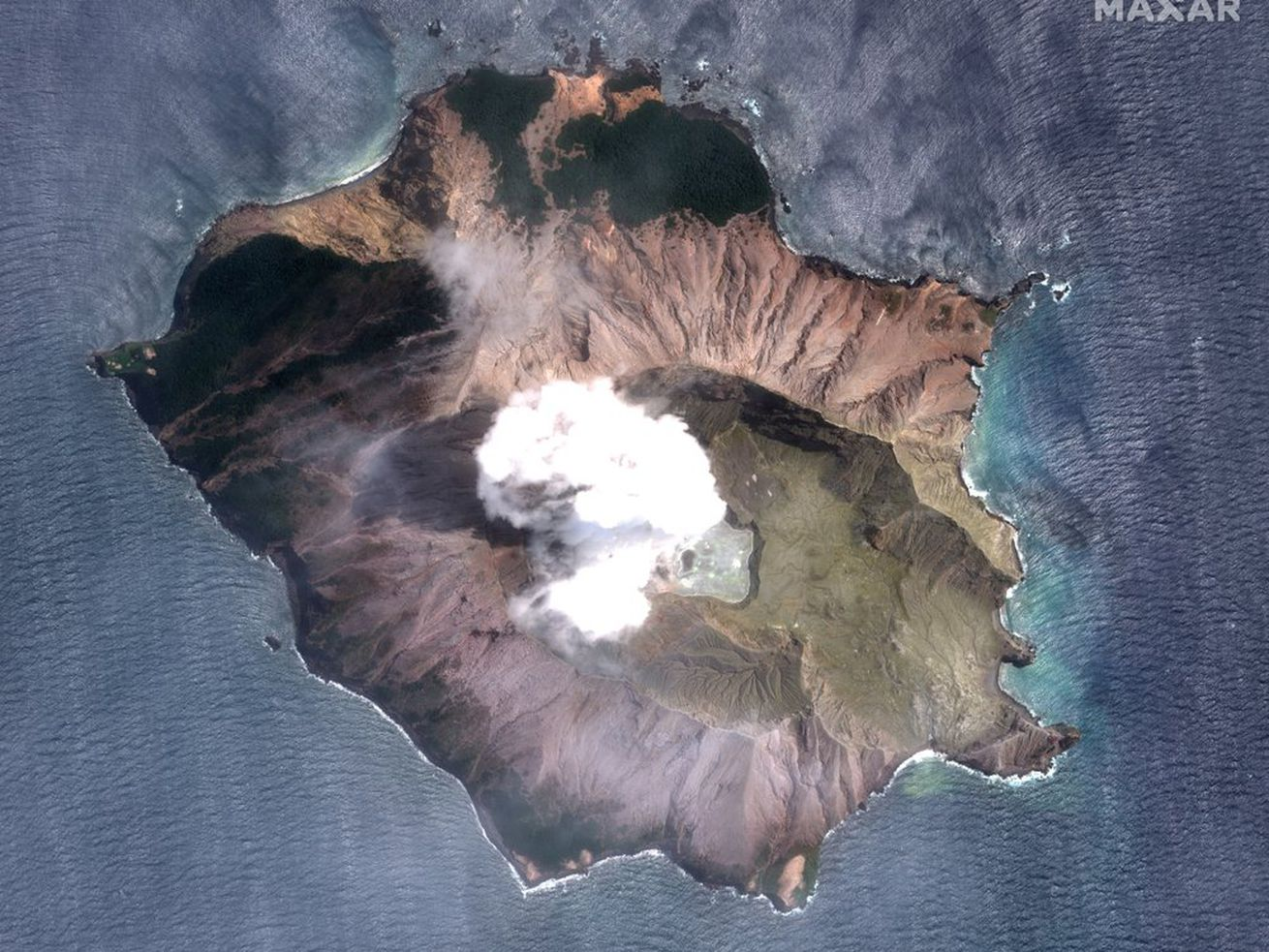 New Zealand planning retrieval of bodies on volcanic island