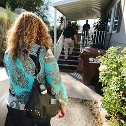 Jeannie Ybarra, of Salt Lake County Criminal Justice Services, and Salt Lake County Sheriff Jason Berg visit a client in Salt Lake City on Thursday, Oct. 6, 2016.