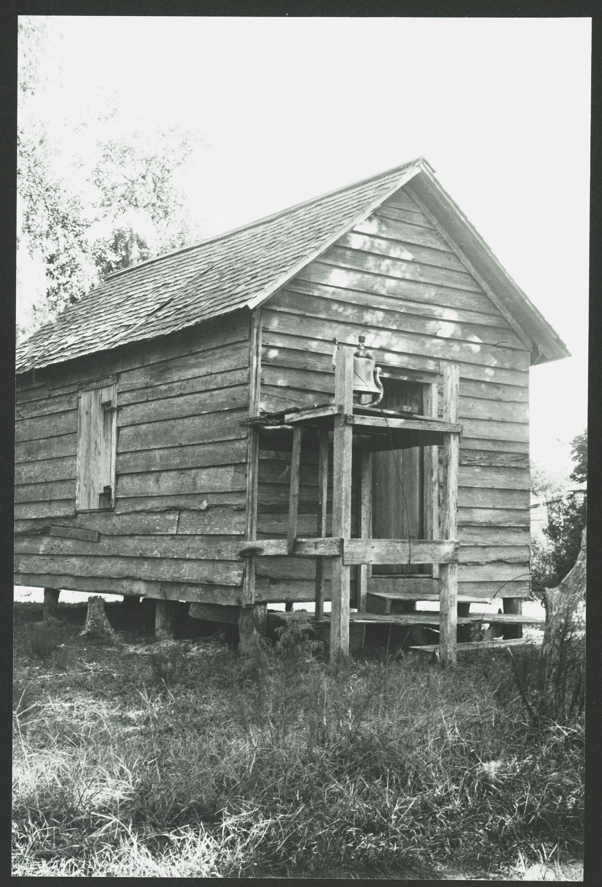 """""""The Black Church,"""" a two-part documentary premiering Tuesday, explores the growth of the church from slave """"praise houses"""" like this one at Sapelo, a rustic cabin type structure used as a church with a bell in front, through the ascent of modern-day megachurches like Chicago's Trinity United Church of Christ."""