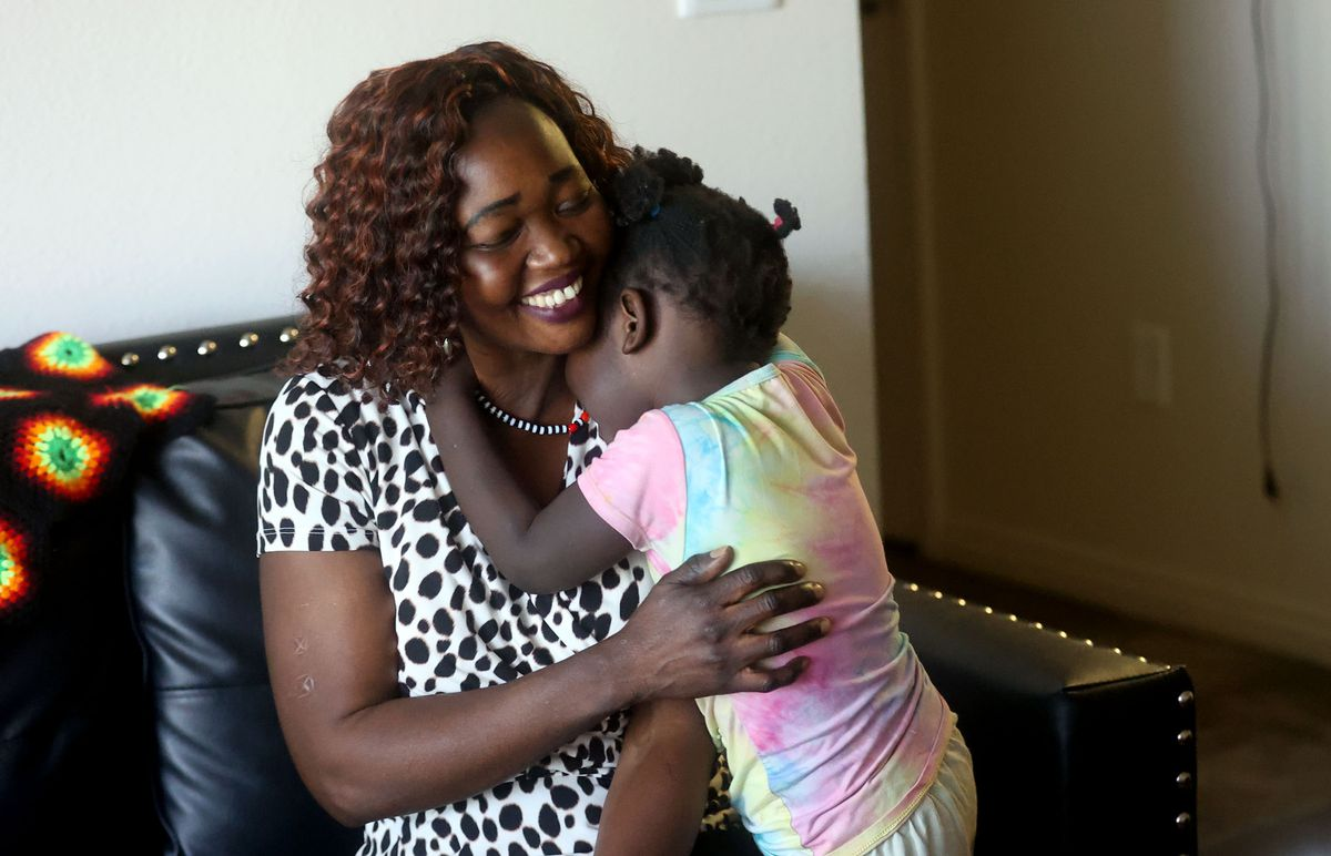 Tabitha Kwayge, a Sudanese refugee, hugs daughter Siyanna Inna at their apartment in Midvale on Wednesday, Sept. 15, 2021. Kwayge is looking for another place for her family to live as the $1,500 monthly rent is too expensive.