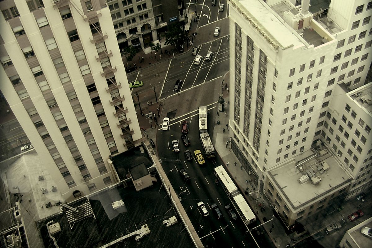 Cars on the street in the SF financial district, seen from above.