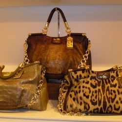 Coach Fall '11: (middle) Dowell Satchel in Python Embossed Copper, $1000