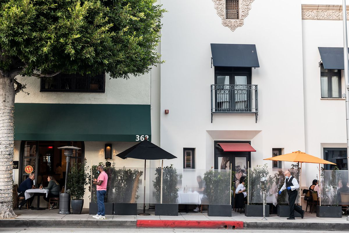 Plexiglas barriers hide customers from the street at a trendy restaurant in Beverly Hills, CA.