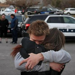 Dallas Tucker holds his girlfriend, Alyssa Miller, a sophomore, after a lockdown at the high school was lifted Thursday, Dec. 3, 2015. Pleasant Grove High School was placed on lockdown after receiving reports of a man with a weapon inside the school.