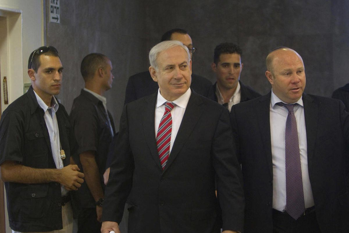 Israel's Prime Minister Benjamin Netanyahu, center, arrives to the weekly cabinet meeting in Jerusalem Sunday, April 29, 2012.