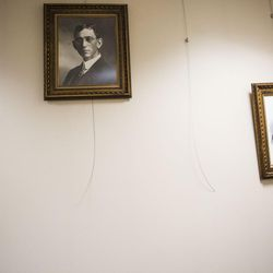 Portraits of past Salt Lake County recorders and wires hang on a wall in the Salt Lake County Recorder's Office in Salt Lake City on Monday, June 5, 2017.
