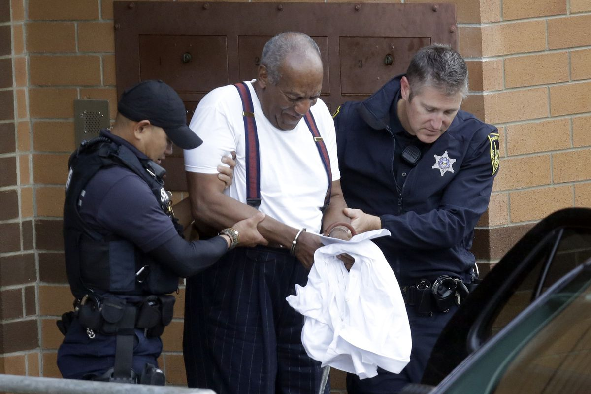Bill Cosby is escorted out of the Montgomery County Correctional Facility, Tuesday, Sept. 25, 2018, in Eagleville, Pa., after receiving a three-to-10-year prison sentence for sexual assault.