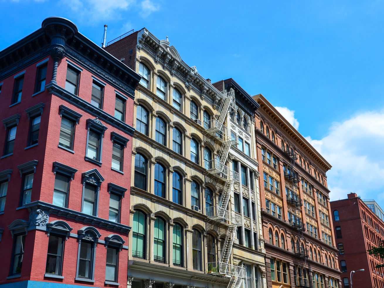 A block of brick-faced apartment buildings in New York City.