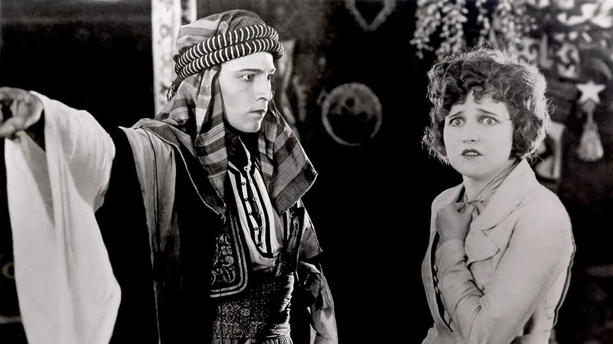 Rudolph Valentino as the Sheik and Agnes Ayres as his victim/lover in 1921's The Sheik