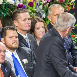 Erika Barney listens as Elder Mervyn B. Arnold, a member of the First Quorum of Seventy of The Church of Jesus Christ of Latter-day Saints, speaks at the funeral services for Unified police officer Doug Barney at the Maverik Center in West Valley City Monday, Jan. 25, 2016.