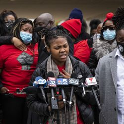 Clifftina Johnson (back, left), Tafara Williams' mother, cries as her daughter, Sasha Williams, sings during a press conference outside Waukegan's city hall complex, Tuesday morning, Oct. 27, 2020. Williams, 20, was wounded and her boyfriend, 19-year-old Marcellis Stinnette, was killed when they were both shot by a Waukegan police officer on Oct. 20.