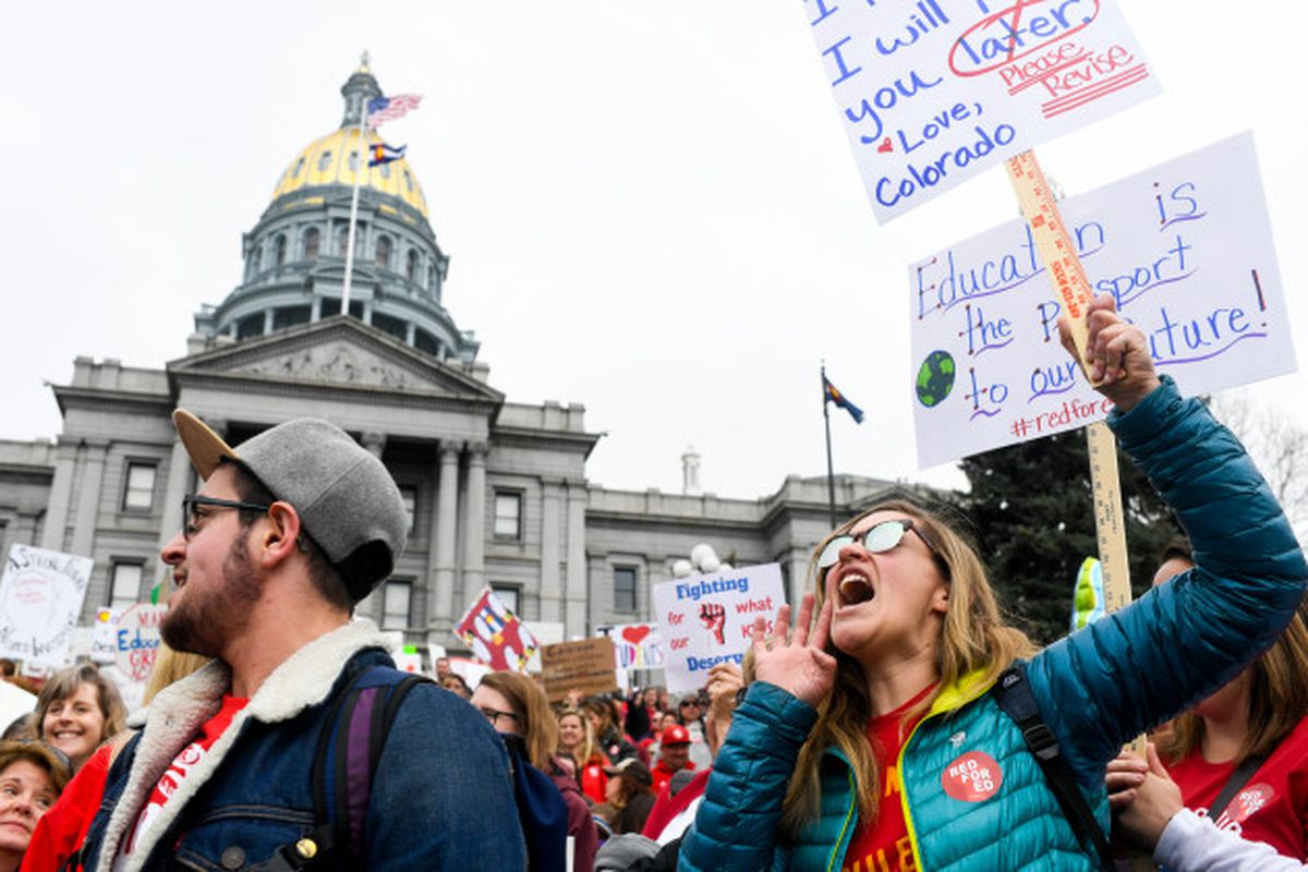 Teachers march during a rally for more educational funding at the Colorado State Capitol in April 2018.