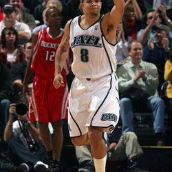 Jazz guard Deron Williams celebrates after scoring over Houston at the Delta Center in 2006.